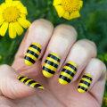 Маникюр желтый с черным: варианты дизайна, модные тенденции